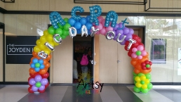 Rainbow balloon arch with balloon alphabets with flowers