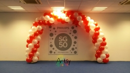 Spiral red and white balloon arch