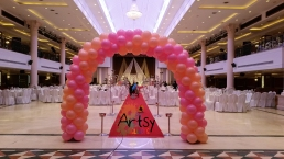 pink and beige balloon spiral arch