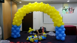 MInion themed yellow and blue balloon arch