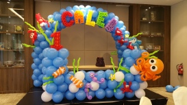 balloon underwater themed backdrop and arch