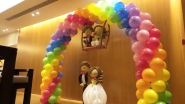 Wedding balloon arch with wedding couple on swing!