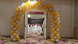 gold and silver balloon arch