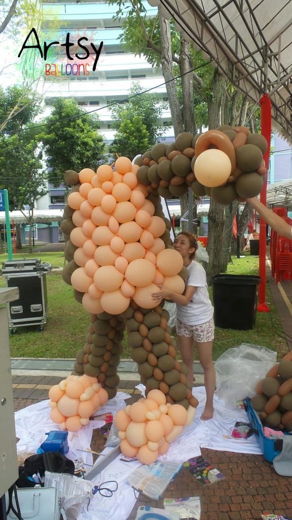 jocelyn-hugging-headless-balloon-monkey.jpg.jpeg