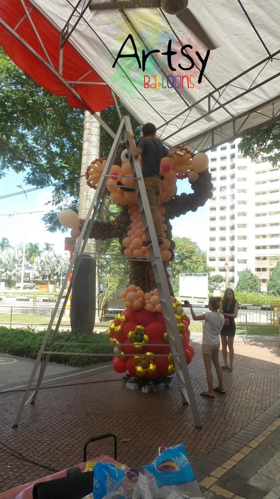 ouji-climbing-up-a-very-tall-ladder-to-fix-the-monkey.jpg.jpeg