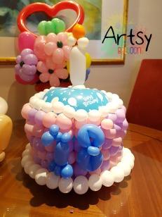 Birthday balloon cake sculpture