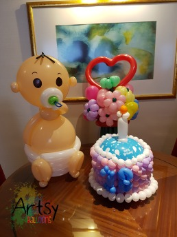 balloon baby sculpture with balloon birthday cake