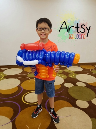 Balloon nerf gun sculpture by Ouji Yeo