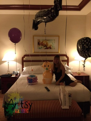 birthday girl with balloon sculptures