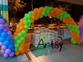 orange and green balloon arch
