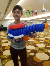 Balloon Sculpting Singapore for birthday parties and events balloon Nerf Gun