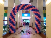 Pink and blue spiral balloon arch