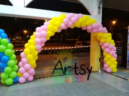 Pink and yellow balloon arch