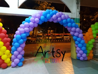 Purple and blue spiral balloon arch