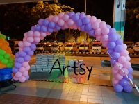 purple and pink spiral balloon arch
