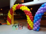 red and yellow spiral balloon arch