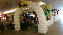 White balloon arch with customised balloon logo