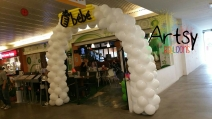 White balloon arch with customised balloon logo