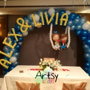 wedding balloon arch decorations with name and wedding couple on swing