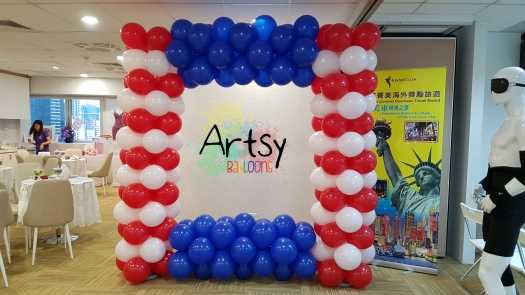 Red, blue and white themed balloon photobooth backdrop