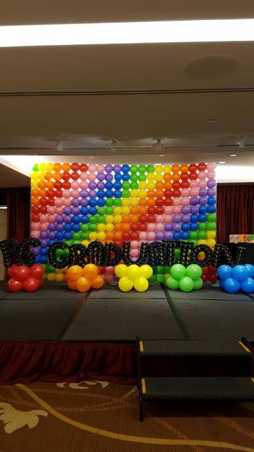Rainbow pixel balloon backdrop with balloon alphabets