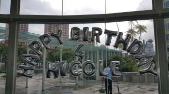 foil alphabets pasted on glass panel balloon decorations with name