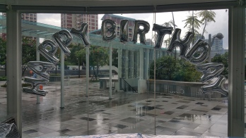 foil alphabets pasted on glass panel balloon decorations