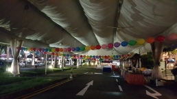 rainbow balloon quicklink tied around tentage