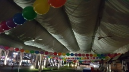 round balloons tied around tentage
