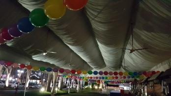 round balloons tied around tentage