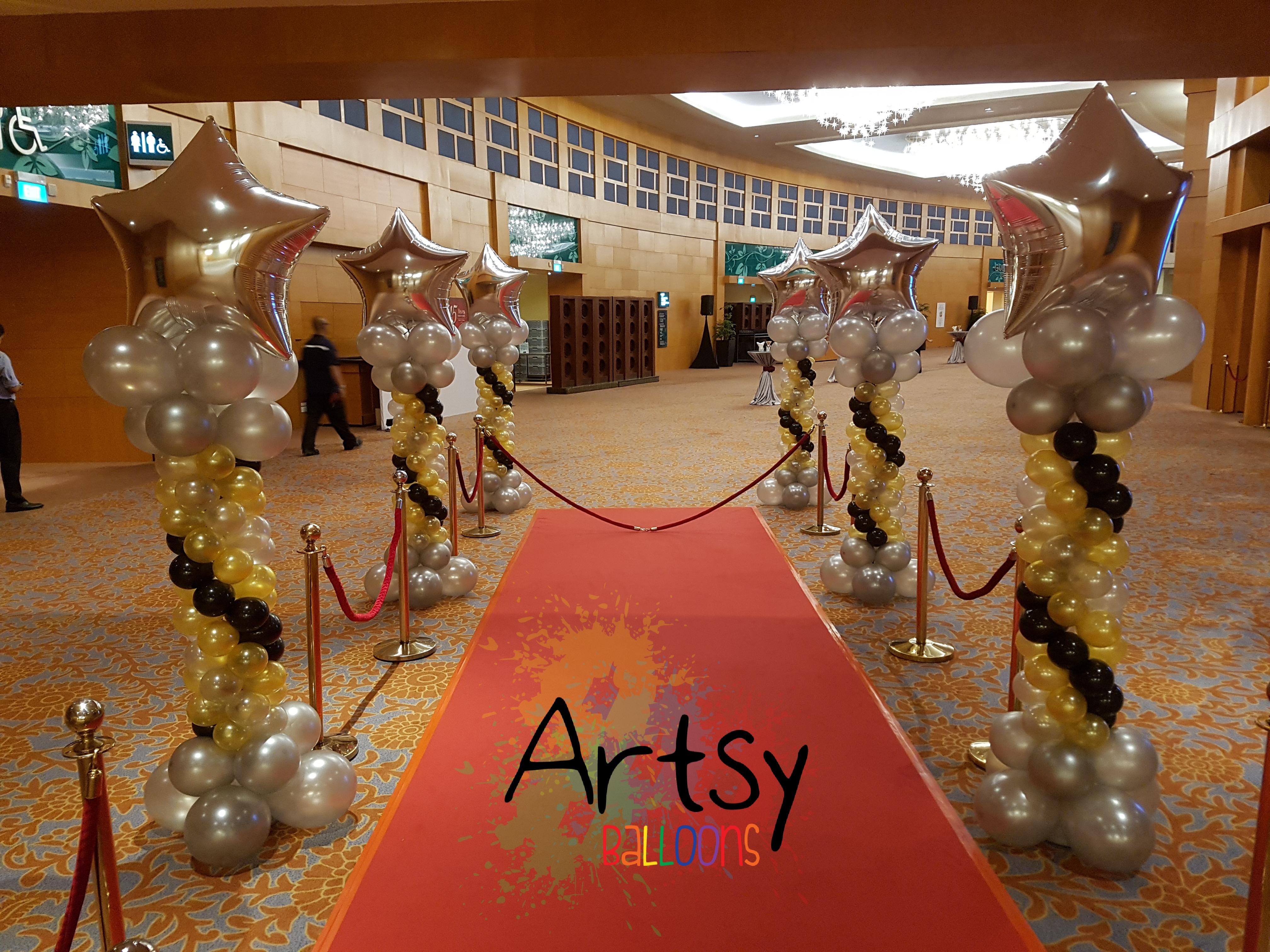 , Setting up balloon columns for Daiso company Dinner and Dance, Singapore Balloon Decoration Services - Balloon Workshop and Balloon Sculpting