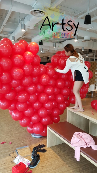 Red balloon heart flat style setting up