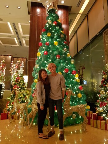 and this christmas tree at the lobby is almost 45 meters tall photo of me and my wife