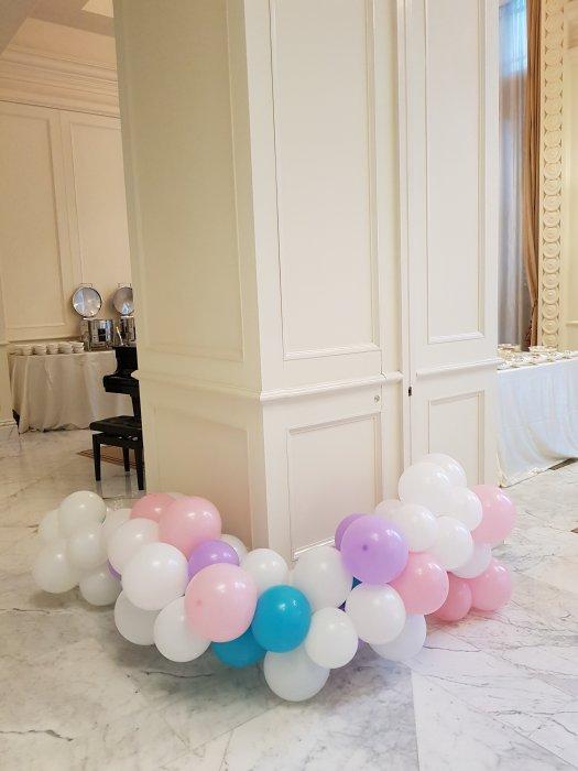 Organic Balloon decorations tied to pillar