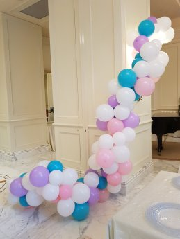 Organic balloon decorations tied to pillars