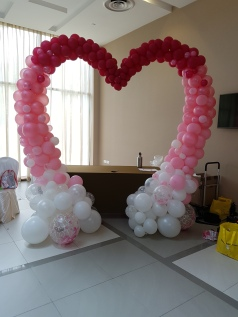 Awesome gradient heart shaped balloon arch! White to pink and lastly red!