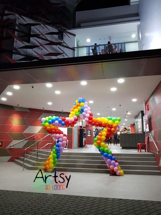 Rainbow star balloon arch