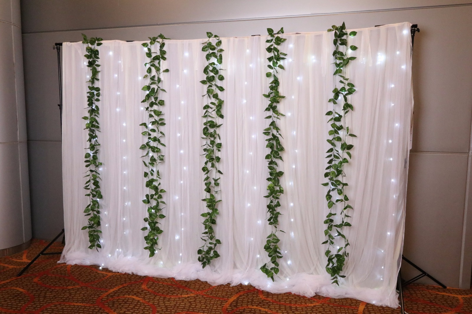 White cloth backdrop with Vines