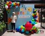 Organic balloon decorations with cardboard backdrop