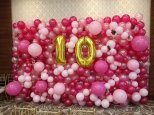 Organic Balloon Backdrop with fake flowers