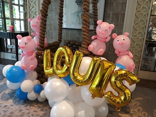 Pig balloon sculptures with Foil Alphabets