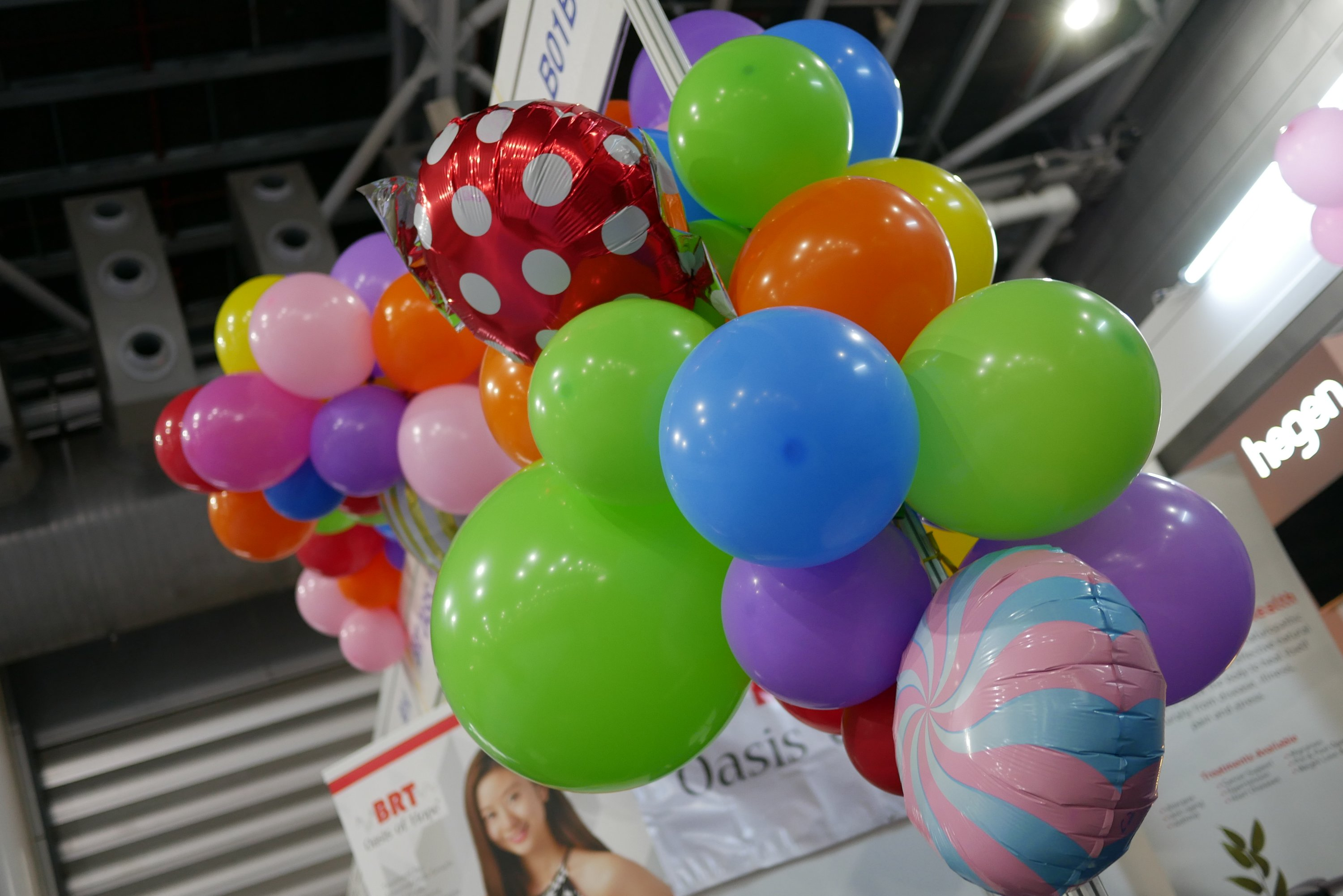 Organic balloon decorations for exhibition booth at Expo