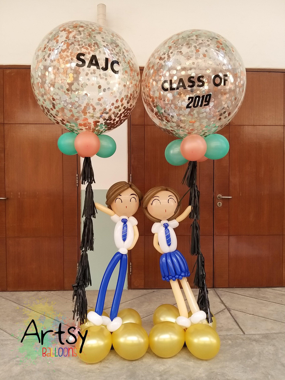 Jumbo confetti customised balloons with pair of balloon student doll sculpture