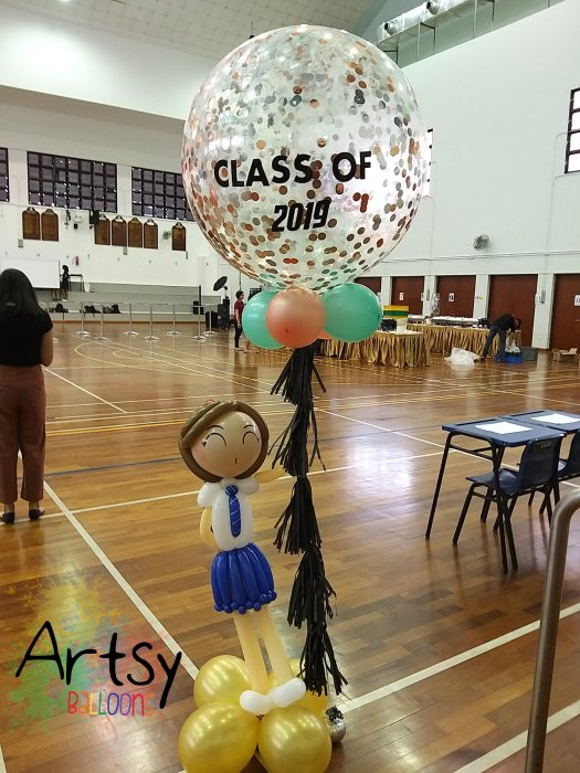 Jumbo confetti customised balloons with pair of balloon student doll sculpture
